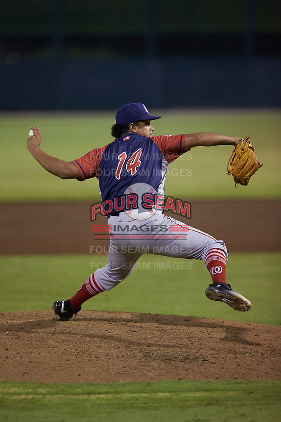 Hagerstown Suns relief pitcher Alfonso Hernandez (14) in action against the Kannapolis Intimidators at Kannapolis Intimidators Stadium on August 27, 2019 in Kannapolis, North Carolina. The Intimidators defeated the Suns 5-4. (Brian Westerholt/Four Seam Images)