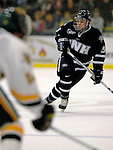 5 January 2007: University of New Hampshire defenseman Kevin Kapstad (5) from Boxboro, MA, in action against the University of Vermont Catamounts at Gutterson Fieldhouse in Burlington, Vermont. The UNH Wildcats defeated Vermont 7-1 in front of a record setting 48th consecutive sellout at &quot;the Gut&quot;...Mandatory Photo Credit: Ed Wolfstein Photo.<br />
