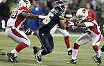 Seattle Seahawks punt return specialists Tyler Lockett is run down by Arizona Cardinals Deone Johnson (20) and Jerraud Powers (25) at CenturyLink Field in Seattle, Washington on November 15, 2015. The Cardinals beat the Seahawks 39-32.   ©2015. Jim Bryant photo. All Rights Reserved.