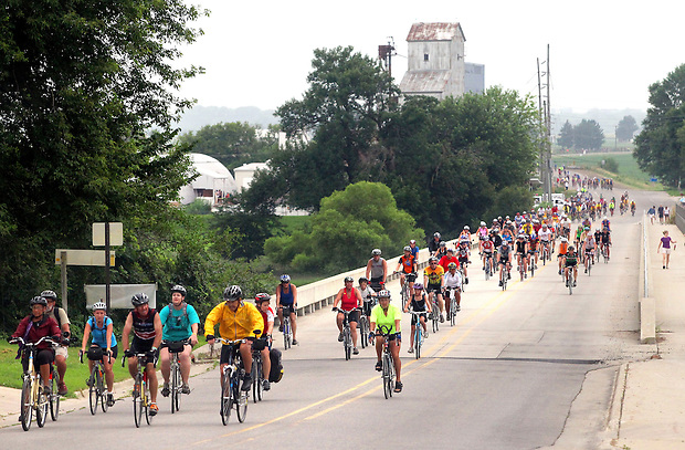 Riders make their way over a bridge into Gilbertville Friday morning on RAGBRAI XXXVIII.