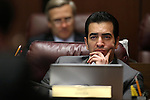 Nevada Sen. Ruben Kihuen, D-Las Vegas, works in committee at the Legislative Building in Carson City, Nev., on Wednesday, May 27, 2015. <br /> Photo by Cathleen Allison