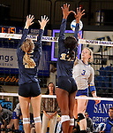 BROOKINGS, SD - OCTOBER 28:  Makenzie Hennen #3 from South Dakota State tips the ball past Shelby Cox #2 and Brianna Greenlee #12 from Oral Roberts Friday night at Frost Arena in Brookings. (Photo by Dave Eggen/Inertia)