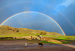 A surprise rainbow over the corrals and roping arena. At the ranch in San Luis Obispo
