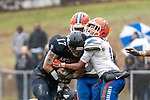 ANSONIA, CT. 02 December 2018-120218 - Ansonia's Tyler Cafaro #17 tries to run through the defense of Bloomfield's Alfonzo Stokes #1 during the Class S Semi-final game between Bloomfield and Ansonia at Ansonia High School in Ansonia on Sunday. Bloomfield held on to beat Ansonia 26-19 and advances to the Class S Championship game next week. Bill Shettle Republican-American