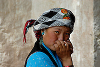 Traditional shy Tibetan girl in the streets of Lhasa Tibet