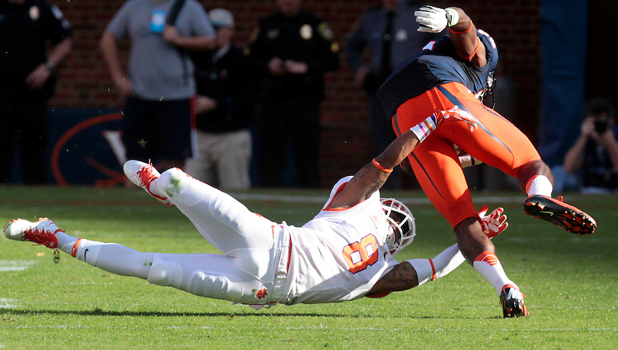 Clemson cornerback Darius Robinson (8) reaches out to tackle Virginia running back Taquan Mizzell (4) during the game Saturday at Scott Stadium in Charlottesville, VA. Clemson defeated Virginia 59-10.  Photo/Andrew Shurtleff