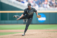Vanderbilt Commodores pitcher Kumar Rocker (80) follows through during Game 8 of the NCAA College World Series against the Mississippi State Bulldogs on June 19, 2019 at TD Ameritrade Park in Omaha, Nebraska. Vanderbilt defeated Mississippi State 6-3. (Andrew Woolley/Four Seam Images)