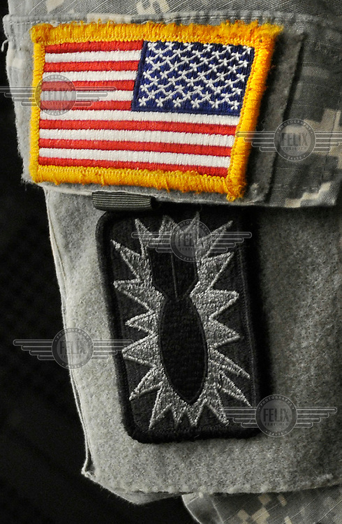 Explosive Ordnance Disposal (EOD) insignia on soldier's arm.
