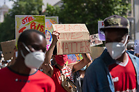 MADRID, SPAIN - JUNE 7: A man shows a placard during the demonstration organized in support of George Floyd and against the racism on June 07 2020, in Madrid, Spain. This demonstration, which began at the USA Embassy, has been produced in the middle of de escalation plans due to COVID-19 outbreak in Spain. The death of George Floyd by police in United States has caused protests against institutional racism and boosted the Black Live Matter movement across the country. It has created an anti-racism movement in multiples cities of Europe as well. (Photo by Sergio Belena/VIEWpress via Getty Images).