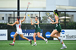 TAMPA, FL - MAY 20: Kasi Cabrey #4 of the Le Moyne Dolphins pushes the ball upfield against the Florida Southern Mocs during the Division II Women's Lacrosse Championship held at the Naimoli Family Athletic and Intramural Complex on the University of Tampa campus on May 20, 2018 in Tampa, Florida. Le Moyne defeated Florida Southern 16-11 for the national title. (Photo by Jamie Schwaberow/NCAA Photos via Getty Images)
