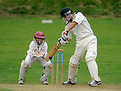 Scottish National Cricket League - First Div - Drumpellier CC V Ayr CC at Langloan, Coatbridge - Drumps batsman Chris Keltie hits out, watched by Ayr's diminutive keeper Seb Stewart - Picture by Donald MacLeod 24.07.10 - mobile 07702 319 738 - clanmacleod@btinternet.com