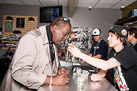 Bud tender Tony Rogers (cq, right) shows marijuana products to Rod Phillips (cq,) at a Medicine Man store in Denver, Colorado, Wednesday, April 8, 2015. Medicine Man boasts that it is one of Denver's largest marijuana operations.<br /> <br /> Photo by Matt Nager