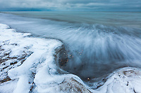 Waves splash along the shore of Barter Island on the Beaufort sea at freeze up.
