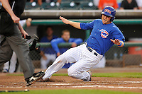 Mike Olt #33 of the Iowa Cubs slides safely into home plate against the New Orleans Zephyrs at Principal Park on July  24, 2014 in Des Moines, Iowa. The Cubs won 11-2.   (Dennis Hubbard/Four Seam Images)
