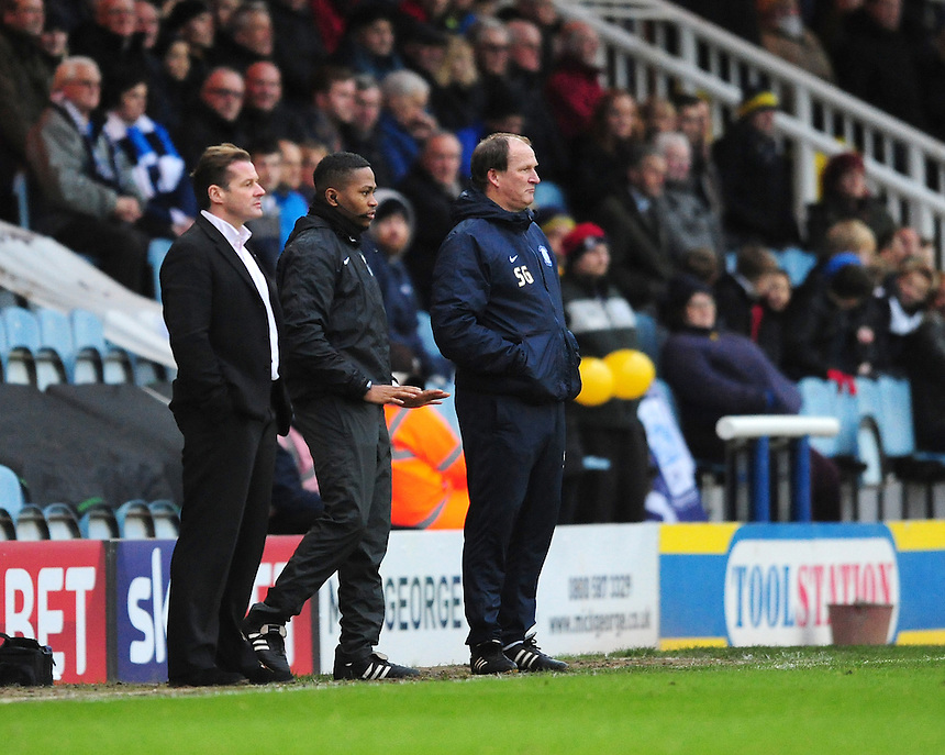 Fourth official Akil Howson speaks to Peterborough United manager Graham Westley, left, and Preston North End manager Simon Grayson <br /> <br /> Photographer Chris Vaughan/CameraSport<br /> <br /> Football - The FA Cup Third Round - Peterborough United v Preston North End - Saturday 9th January 2016 - ABAX Stadium - Peterborough <br /> <br /> &copy; CameraSport - 43 Linden Ave. Countesthorpe. Leicester. England. LE8 5PG - Tel: +44 (0) 116 277 4147 - admin@camerasport.com - www.camerasport.com
