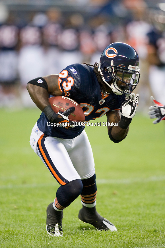 CHICAGO - AUGUST 7: Wide receiver Devin Hester #23 of the Chicago Bears gains yardage after a reception against the Kansas City Chiefs at Soldier Field on August 7, 2008 in Chicago, Illinois. The Chiefs defeated the Bears 24-20. (AP Photo/David Stluka)