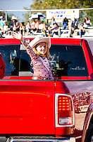 Girl waves in truck at 65th year of The Homestead Rodeo, Homestead, FL, on January 26, 2014