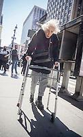An elderly women with her walker in Midtown Manhattan in New York on Monday, April 11, 2016. (© Richard B. Levine)