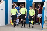 Referee Mr O Yates leads the teams out during Colchester United vs Northampton Town, Sky Bet EFL League 2 Football at the JobServe Community Stadium on 24th August 2019