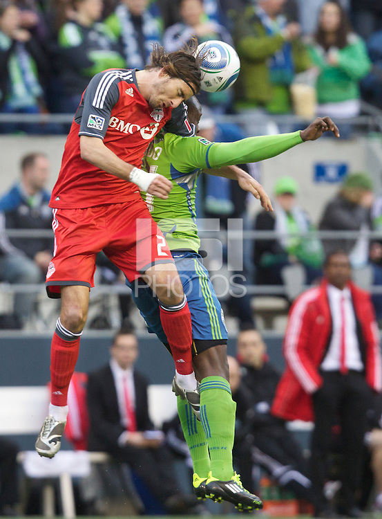 Toronto FC forward Alan Gordon battles Seattle Sounders FC defender Jhon Kennedy Hurtado  for the ball during play at Qwest Field in Seattle Saturday April 30, 2011. The Sounders won the game 3-0.