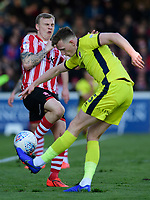 Lincoln City's Harry Anderson vies for possession with Cheltenham Town's William Boyle<br /> <br /> Photographer Chris Vaughan/CameraSport<br /> <br /> The EFL Sky Bet League Two - Lincoln City v Cheltenham Town - Saturday 13th April 2019 - Sincil Bank - Lincoln<br /> <br /> World Copyright © 2019 CameraSport. All rights reserved. 43 Linden Ave. Countesthorpe. Leicester. England. LE8 5PG - Tel: +44 (0) 116 277 4147 - admin@camerasport.com - www.camerasport.com
