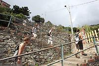 Escursionisti percorrono i 377 scalini della Lardarina per raggiungere il borgo di Corniglia dalla stazione ferroviaria, alle Cinque Terre.<br /> Hikers make their way along the 377 'Lardarina' steps to reach the village of Corniglia from the railway station, at the Cinque Terre.<br /> UPDATE IMAGES PRESS/Riccardo De Luca