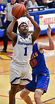 Alton Marquette guard Iggy McGee drives to the basket past Roxana guard Gavin Huffman. Alton Marquette played Roxana in the Class 2A Roxana boys basketball regional final at Roxana High School in Roxana, Illinois on Friday February 28, 2020. <br />Tim Vizer/Special to STLhighschoolsports.com
