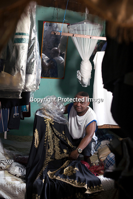 "KINSHASA, DEMOCRATIC REPUBLIC OF CONGO - FEBRUARY 12: Khaditoza Gola, the leader of the Leopard Sapeur shows his big clothing collection in his home on February 12, 2017 in Kinshasa, DRC. The word Sapeur comes from SAPE, a French acronym for Sociéé des Ambianceurs et Persons Élégants. or Society of Revellers and Elegant People. It also means to dress with ""elegance and style"". Most of the young Sapeurs are unemployed, poor and live in harsh conditions in Kinshasa, a city of about 10 million people. For many of them being a Sapeur means they can escape their daily struggles and dress like fashionable Europeans. Many hustle to build up their expensive collections. Most Sapeurs could never afford to visit Paris, and usually relatives send or bring clothes back to Kinshasa. Mr. Khaditoza has one of the largest collections of clothes, shoes and accessories of all Sapeurs. (Photo by Per-Anders Pettersson)"
