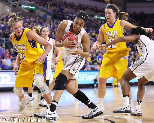 SIOUX FALLS, SD: MARCH 6: Mikale Rogers #33 of IUPUI grabs a rebound between Clarissa Ober #21 and Sydney Palmer #32 of South Dakota State during the Summit League Basketball Championship on March 6, 2017 at the Denny Sanford Premier Center in Sioux Falls, SD. (Photo by Dick Carlson/Inertia)