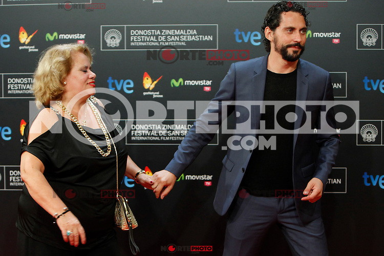 Spanish actor Paco Leon and his mother, Carmina Barrios, poses for the photographres during the red carpet of the film 'Automata' during the 62st San Sebastian Film Festival in San Sebastian, Spain. September 21, 2014. (ALTERPHOTOS/Caro Marin)