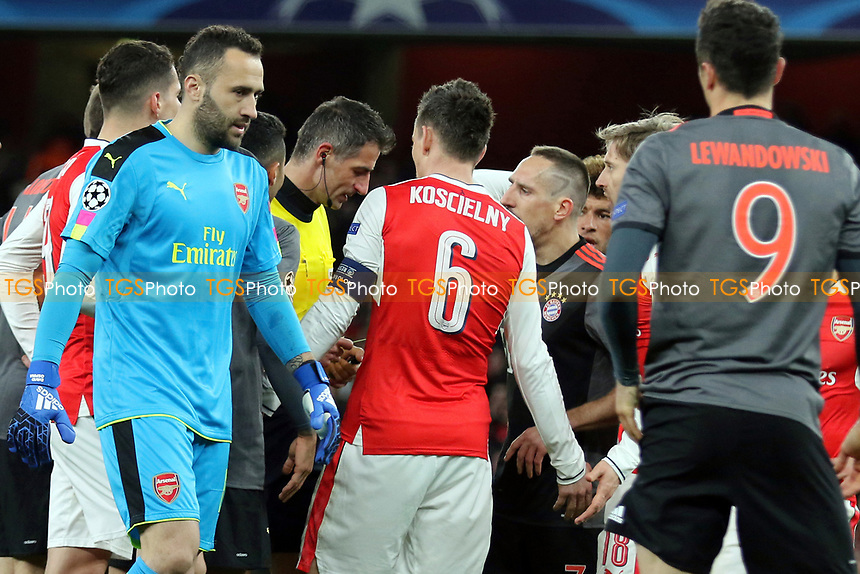 Bayern Munich players urge the referee to show Arsenal's Laurent Koscielny a red card after fouling Robert Lewandowski during Arsenal vs FC Bayern Munich, UEFA Champions League Football at the Emirates Stadium on 7th March 2017