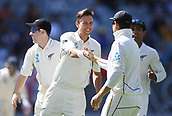 22nd March 2018, Eden Park, Auckland, New Zealand; International Test Cricket, New Zealand versus England, day 1;  Trent Boult celebrates wiht team mates the wicket of Malan