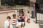 September 14, 2011. Raleigh, NC. . Kim Jackson, the head teacher for the class, leads her students back into the building after recess.. Project Enlightenment, a public pre-kindergarten program for at risk children, has been threatened with closure due to state wide budget cuts..