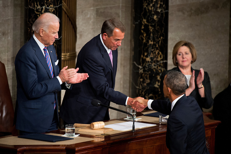 UNITED STATES - JANUARY 20: President Barack Obama greets Speaker John Boehner, R-Ohio, as Vice President Joe Biden looks on, in the Capitol's House chamber before Obama delivered his State of the Union address, January 20, 2015. (Photo By Tom Williams/CQ Roll Call)