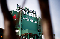 """The back side of a new High Definition (HD) video screen standing above center field reads """"Fenway Park, Home of the Boston Red Sox"""" at Fenway Park in Boston, Massachusetts, USA."""