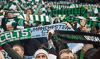A sea of Celtic scarves are raised during the UEFA Champions League GROUP match between Manchester City and Celtic at the Etihad Stadium, Manchester, England on 6 December 2016. Photo by Andy Rowland.