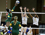SIOUX FALLS, SD - DECEMBER 8:  Abbie Lynn #7 and Tulani Titley #22 from Angelo State tries for a block on a tip by Chrisalyn Johnson #9 from Alaska Anchorage in the Women's Division II Volleyball Championship Thursday at the Sanford Pentagon in Sioux Falls, SD.  (Photo by Dave Eggen/Inertia)