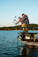 Day one the U.S. Open Bowfishing Championship including a trip onto the lake with Nick Wright (cq, left), Rich Porter (cq), Friday, May 2, 2014. The event is hosted and sponsored by Bass Pro Shops. The guys are not actually fishing here but rather testing their boat and bows.<br /> <br /> Photo by Matt Nager
