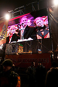 "Kiev, Ukraine.December 26, 2004..A pro-Viktor Yushchenko rally in Kiev as election polls close. He is joined on stage by his wife Kathy, two children as well as his political partner Yulia Timoshenko. ..Images of the stage are shown on two large screens set up at the ends of the stage...Supporters rally to support him as first election polls show him in a strong lead. ..The first round of voting was considered fraudulent when the ruling president Viktor Yahukovich won and the opposition candidate Viktor Yushchenko lost. ..Several hundred thousand Ukrainians took to the streets of Kiev and held daily rallies on Maidan Independence Square. The protests lasted nearly a month before the first vote was declared invalid and a new round of elections held on December 26, 2004. ..The demonstrations would come to be known as the ""Orange Revolution"" after the color of the opposition party."