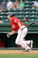 Catcher Jake Romanski (12) of the Greenville Drive bats in a game against the Lexington Legends on Sunday, April 27, 2014, at Fluor Field at the West End in Greenville, South Carolina. Greenville won, 21-6. (Tom Priddy/Four Seam Images)