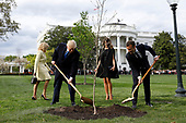 U.S. President Donald Trump with France's president Emmanuel Macron and First Ladies Melania Trump and Brigitte Macron plant a tree, a gift from the President and Mrs. Macron, on the South Lawn of the White House in Washington, D.C., U.S., on Monday, April 23, 2018. As Macron arrives for the first state visit of Trump's presidency, the U.S. leader is threatening to upend the global trading system with tariffs on China, maybe Europe too.<br /> Credit: Yuri Gripas / Pool via CNP