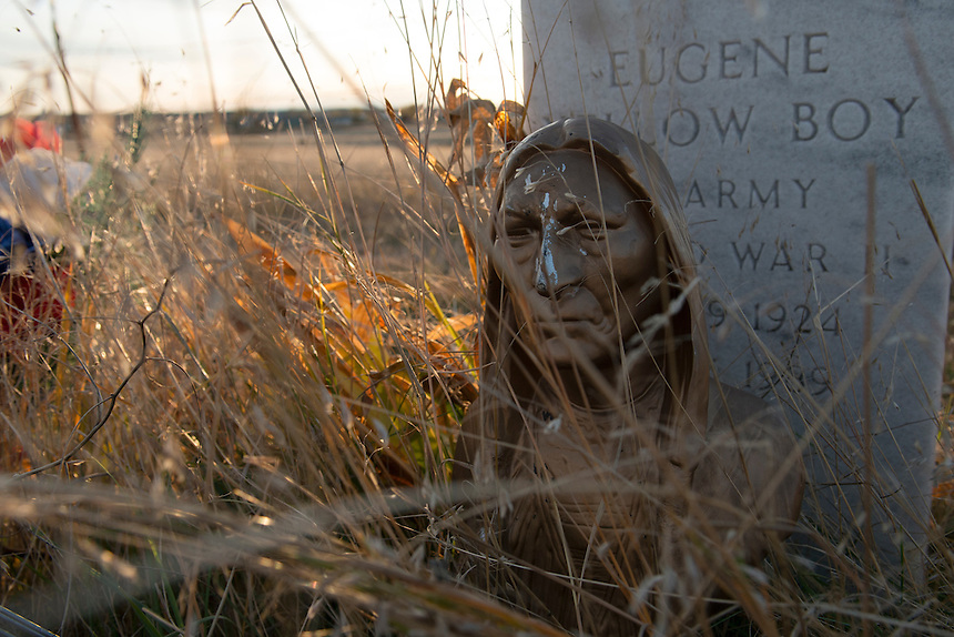 Sculpture of a warrior adorns the grave of Eugene Yallow Boy at the cemetery of Wolf Creek, Pine Ridge Indian Reservation.