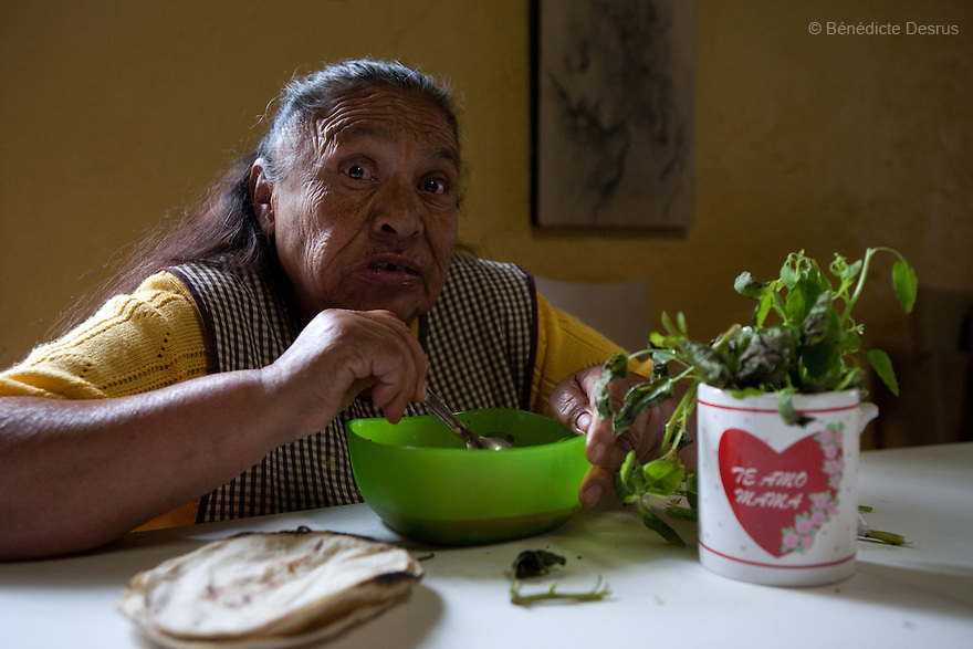 Conchita, a resident of Casa Xochiquetzal during lunch time at the shelter in Mexico City, Mexico on July 28, 2008. Casa Xochiquetzal is a shelter for elderly sex workers in Mexico City. It gives the women refuge, food, health services, a space to learn about their human rights and courses to help them rediscover their self-confidence and deal with traumatic aspects of their lives. Casa Xochiquetzal provides a space to age with dignity for a group of vulnerable women who are often invisible to society at large. It is the only such shelter existing in Latin America. Photo by Bénédicte Desrus