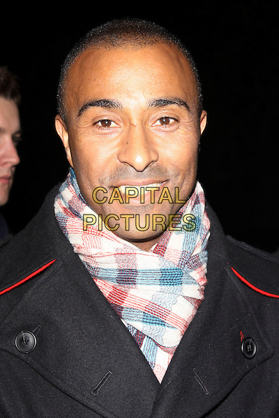 COLIN JACKSON.The Quintessentially 10th anniversary party, Savoy hotel, London, England..December 13th, 2010.headshot portrait black white red gingham scarf.CAP/AH.©Adam Houghton/Capital Pictures.