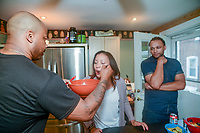 From left, Kevin Overton, of Philadelphia holds a spoon as his sister Sally Armstrong of Dallas, Texas tastes his cooking as her husband Rodney Armstrong looks on Saturday, May 19, 2018 in Philadelphia, Pennsylvania. Sally Armstrong used a 23andMe Health + Ancestry kit to find her four half siblings. She met them for the first time Friday. (Photo by William Thomas Cain/CAIN IMAGES)