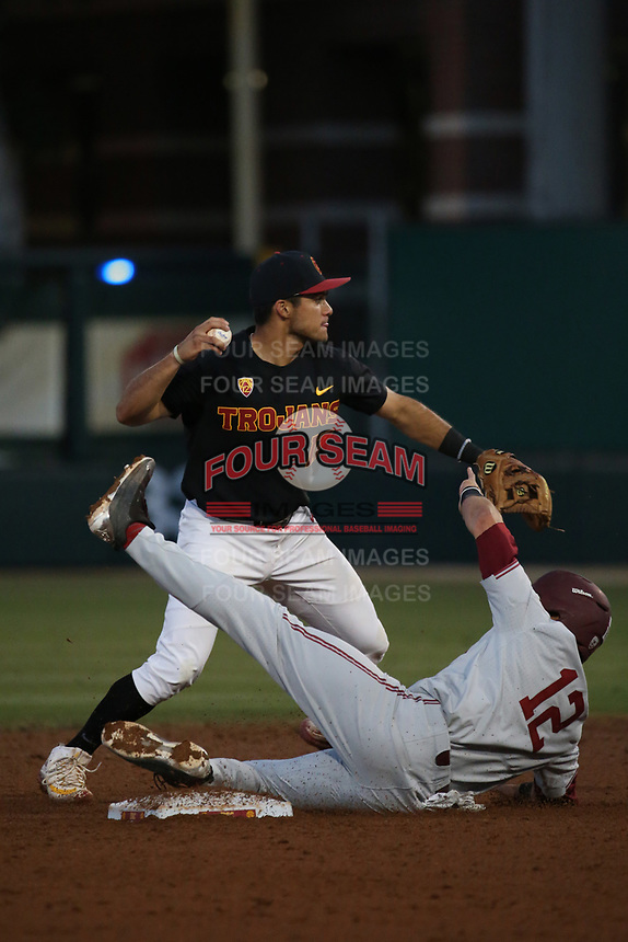 Frankie Rios (17) of the Southern California Trojans throws to first base after forcing out Duke Kinamon (12) of the Stanford Cardinal at second base during a game at Dedeaux Field on April 6, 2017 in Los Angeles, California. Southern California defeated Stanford, 7-5. (Larry Goren/Four Seam Images)