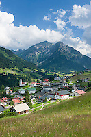 Austria, Vorarlberg, Kleinwalsertal, Hirschegg: village centre with catholic church Saint Anne, evangelic Cross Church and Allgaeu Alps | Oesterreich, Vorarlberg, Kleinwalsertal, Hirschegg: Ortszentrum mit katholischer St. Anna Kirche und der evangelischen Kreuzkirche vor den Allgaeuer Alpen