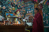 Bhutan, Paro. Zhiwa Ling Hotel. Monk performing blessing ceremony.