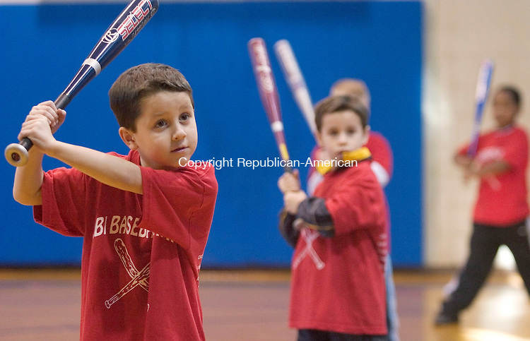 WATERBURY, CT- 06 FEBRUARY 2005-020605JS03--Kyle Torok, 6, of Waterbury listens to the instruction as he practice batting skills during the RBI Camp held Sunday at the Anderson Boys' Club of Waterbury. The RBI Camp, or Reviving Baseball in Inner Cities, under the direction of camp director Jay Maia, teaches yourh not only the fundamentals of baseball but life skills including resisting drugs and developing a positive self-esteem. -- Jim Shannon Photo--Kyle Torok; RBI Camp; Anderson Boys' Club of Waterbury,  Jay Maia are CQ