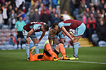 Burnley's Thomas Heaton is surrounded by team mates after a collision during the premier league match at the Turf Moor Stadium, Burnley. Picture date 10th September 2017. Picture credit should read: Paul Burrows/Sportimage